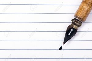 3518719-A-blank-page-that-is-open-with-a-calligraphy-pen-on-top--Stock-Photo